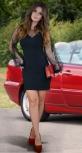 Элегантное черное платье с V-образным декольте и пышными рукавами
