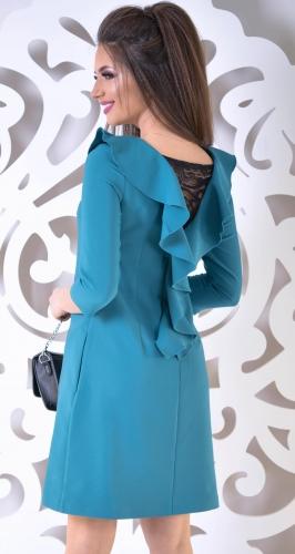 Очаровательное платье цвета изумруд